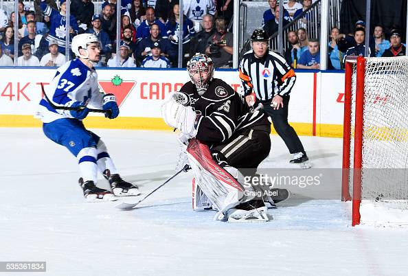 Colin Smith of the Toronto Marlies fires a shot past Justin Peters of the Hershey Bears during AHL Eastern Conference Final playoff game action on...
