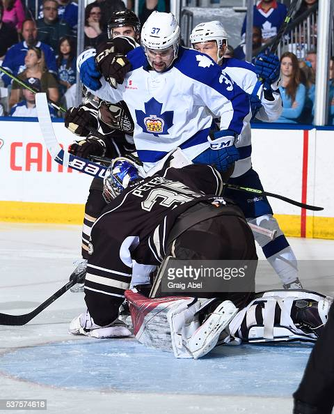 Colin Smith of the Toronto Marlies looks for loose puck from goalie Justin Peters of the Hershey Bears during AHL Eastern Conference Final playoff...
