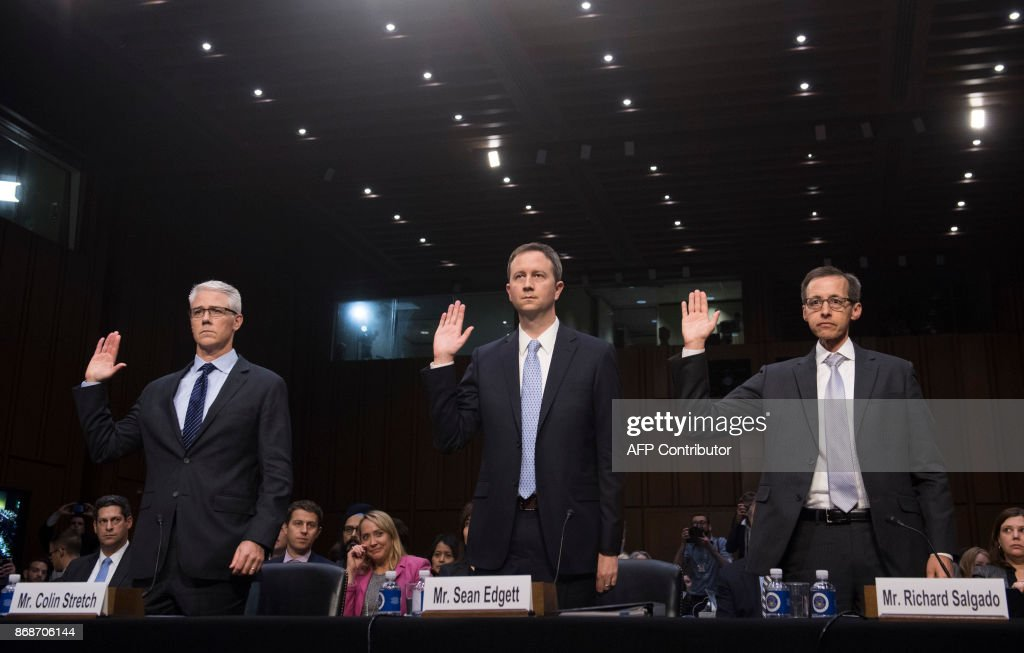 Colin Stretch (L), General Counsel of Facebook, Sean Edgett (C), Acting General Counsel of Twitter, and Richard Salgado (R), Director of Law Enforcement And Information Security of Google, are sworn in prior to testifying during a US Senate Judiciary Subcommittee on Crime and Terrorism hearing on Russian influence on social networks on Capitol Hill in Washington, DC, October 31, 2017. /