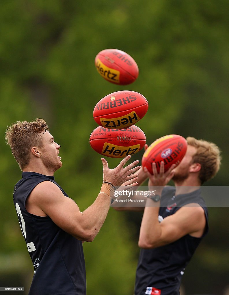<a gi-track='captionPersonalityLinkClicked' href=/galleries/search?phrase=Colin+Sylvia&family=editorial&specificpeople=234706 ng-click='$event.stopPropagation()'>Colin Sylvia</a> gathers the ball during a Melbourne Demons AFL pre-season training session at Gosch's Paddock on November 26, 2012 in Melbourne, Australia.