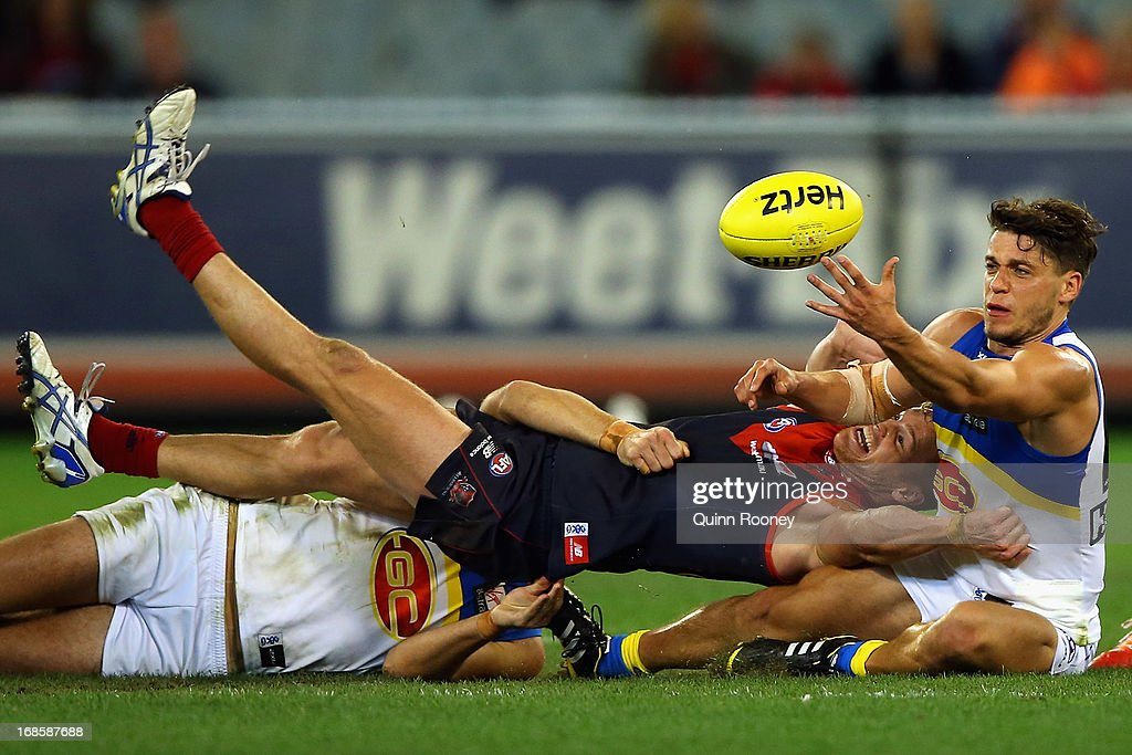 Colin Sylvia of the Demons and Dion Prestia of the Suns contest for the ball during the round seven AFL match between the Melbourne Demons and the Gold Coast Suns at Melbourne Cricket Ground on May 12, 2013 in Melbourne, Australia.