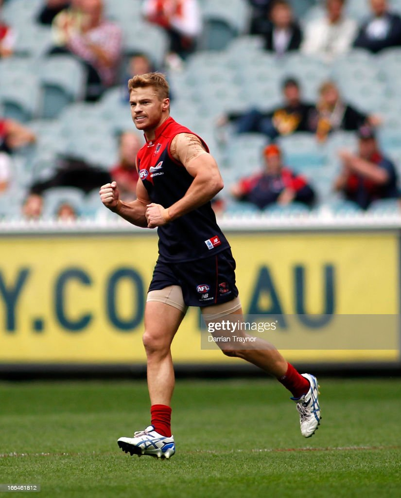 <a gi-track='captionPersonalityLinkClicked' href=/galleries/search?phrase=Colin+Sylvia&family=editorial&specificpeople=234706 ng-click='$event.stopPropagation()'>Colin Sylvia</a> of the Demons celebrates a goal during the round three AFL match between the Melbourne Demons and the West Coast Eagles at Melbourne Cricket Ground on April 13, 2013 in Melbourne, Australia.