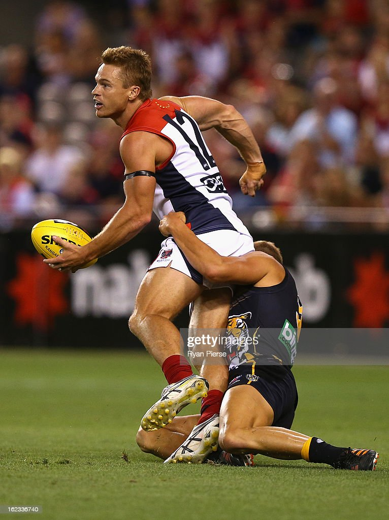 <a gi-track='captionPersonalityLinkClicked' href=/galleries/search?phrase=Colin+Sylvia&family=editorial&specificpeople=234706 ng-click='$event.stopPropagation()'>Colin Sylvia</a> of the Demons is tackled during the round one AFL NAB Cup match between the Richmond Tigers and the Melbourne Demons at Etihad Stadium on February 22, 2013 in Melbourne, Australia.