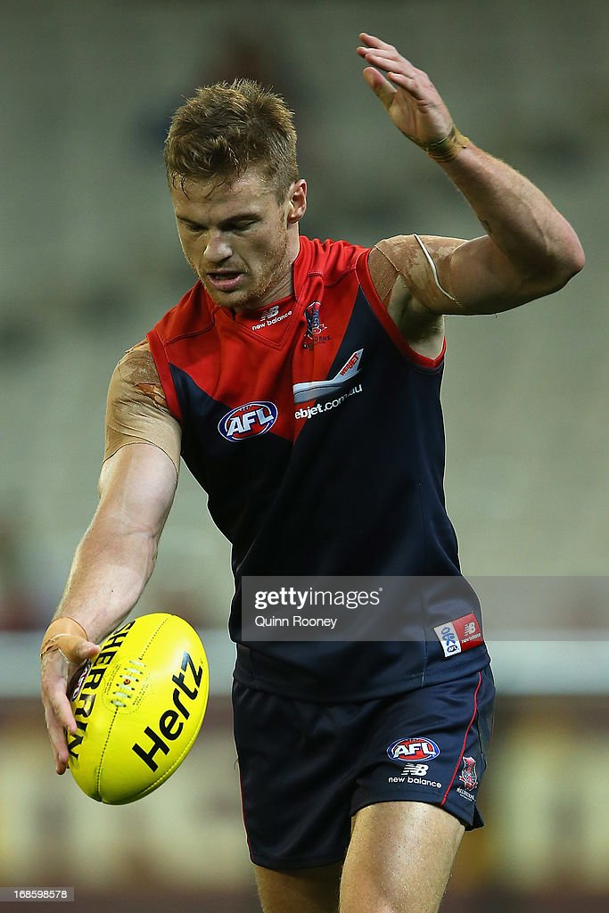 Colin Sylvia of the Demons kicks during the round seven AFL match between the Melbourne Demons and the Gold Coast Suns at Melbourne Cricket Ground on May 12, 2013 in Melbourne, Australia.