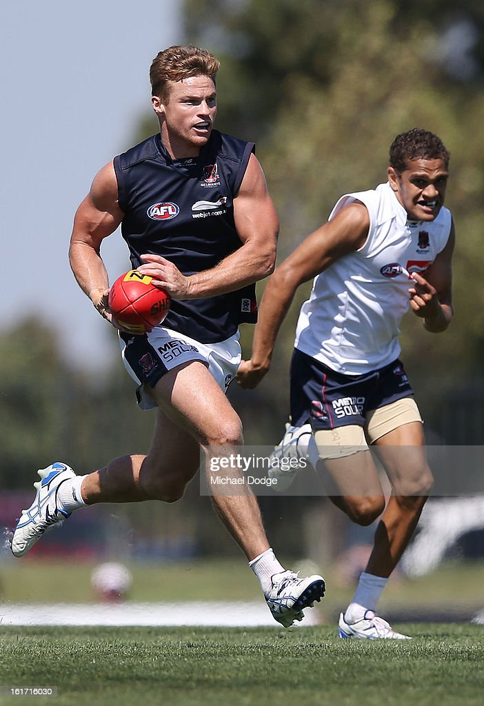 <a gi-track='captionPersonalityLinkClicked' href=/galleries/search?phrase=Colin+Sylvia&family=editorial&specificpeople=234706 ng-click='$event.stopPropagation()'>Colin Sylvia</a> runs with the ball ahead of Dom Barry during a Melbourne Demons intra-club match session at Casey Fields on February 15, 2013 in Melbourne, Australia.