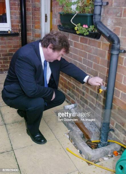 Colin Topp an independent expert examines a drain at a terraced house in Leatherhead Surrey where Surrey Trading Standards officers set up a sting...