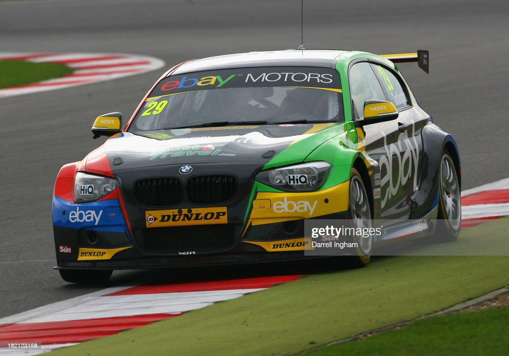 Colin Turkington drives the #29 eBay Motors BMW 125i Sport during practice for the Dunlop MSA British Touring Car Championship race at the Silverstone Circuit on September 28, 2013 in Towcester, United Kingdom.