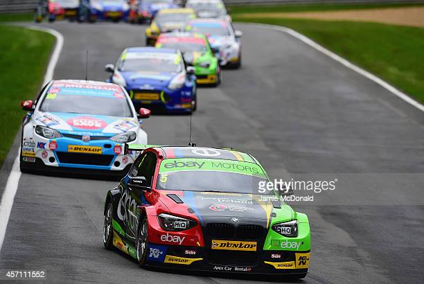 Colin Turkington of Ebay Motors during Race 2 of the Dunlop MSA British Touring Car Championship at Brands Hatch on October 12 2014 in Longfield...