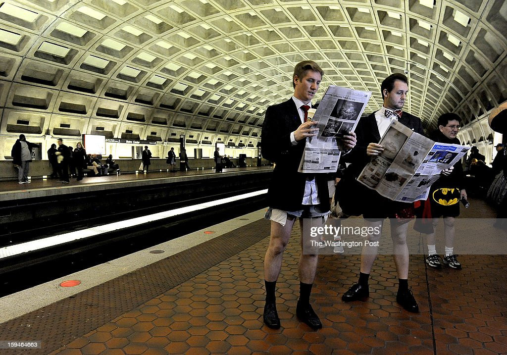 Colin VanDercreek and Jesse Helfrich read their paper as is it's a normal work day heading to the office. They were participants in the annual No Pants Subway Ride. It was started in NYC over a decade ago and has been celebrated in this area for the past 5 years (this year is the 6th). Photo by Michael S. Williamson/The Washington Post via Getty Images
