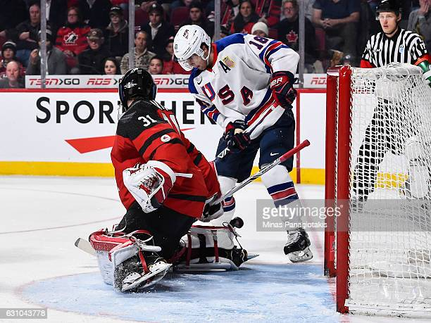Colin White of Team United States gets the puck behind Carter Hart of Team Canada and scores to tie the game in the third period during the 2017 IIHF...