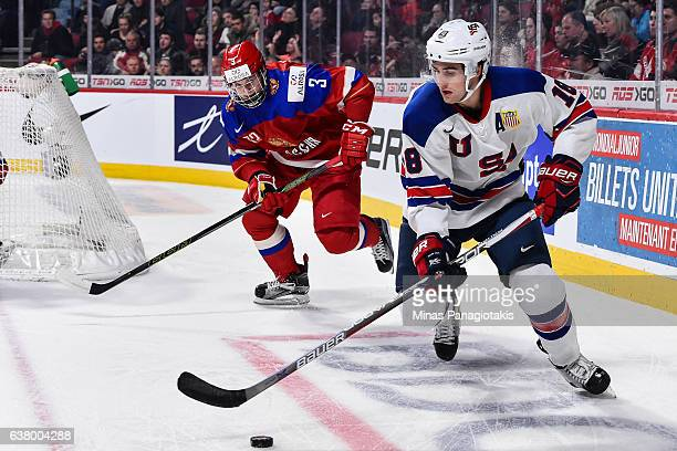 Colin White of Team United States skates the puck past Mikhail Sidorov of Team Russia during the 2017 IIHF World Junior Championship semifinal game...
