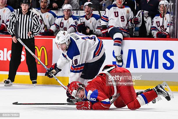 Colin White of Team United States takes down Kirill Urakov of Team Russia during the 2017 IIHF World Junior Championship semifinal game at the Bell...
