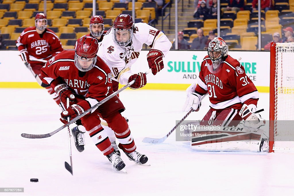 Colin White of the Boston College Eagles defends Sean Malone of the Harvard Crimson during the first period at TD Garden on February 1 2016 in Boston...