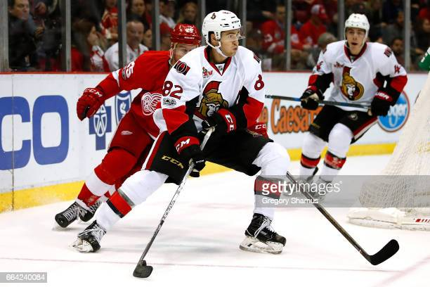 Colin White of the Ottawa Senators tries to escape the defense of Mike Green of the Detroit Red Wings during the second period at Joe Louis Arena on...