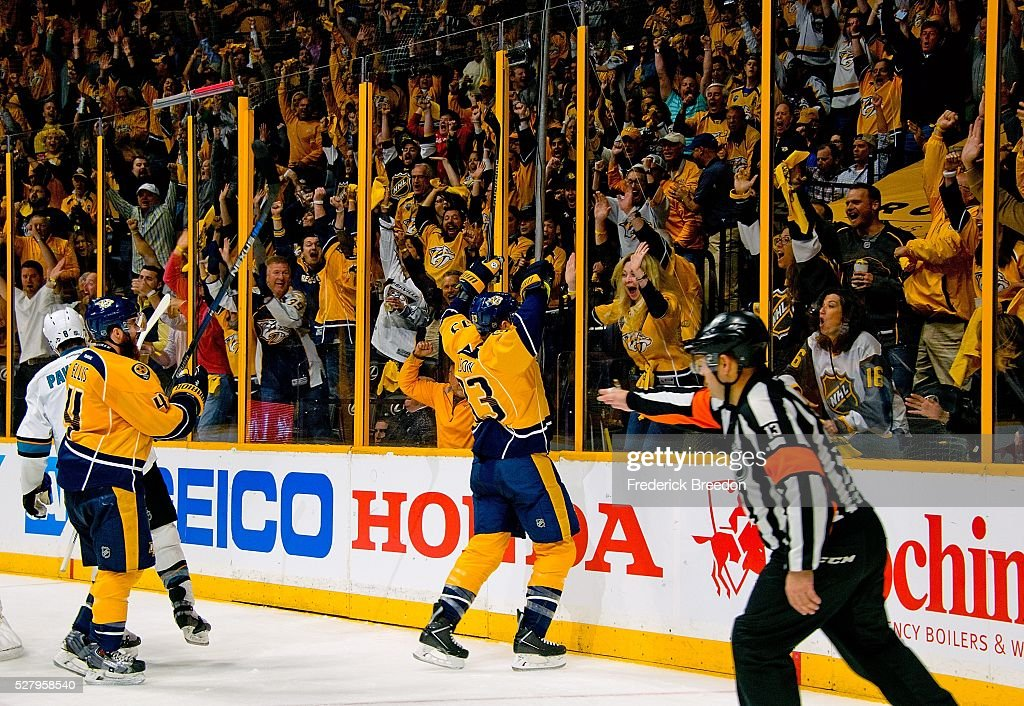 Colin Wilson #33 celebrates with fans as referee Dan O'Halloran #13 signals goal against of the San Jose Sharks during the third period of Game Three of the Western Conference Second Round during the 2016 NHL Stanley Cup Playoffs at Bridgestone Arena on May 3, 2016 in Nashville, Tennessee.