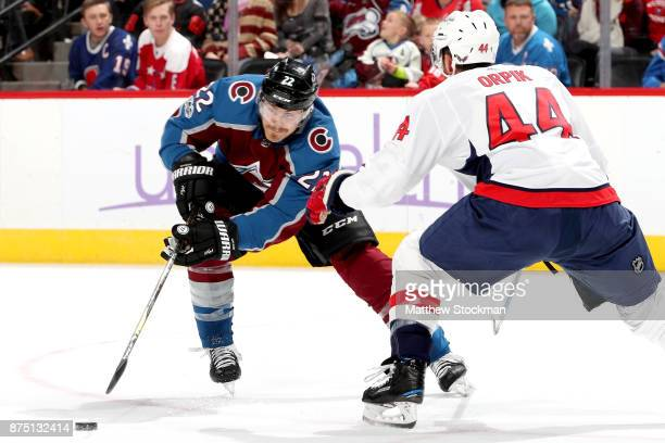 Colin Wilson of the Colorado Avalanche advances the puck against Brooks Orpik of the Washington Capitals at Pepsi Center on November 16 2017 in...