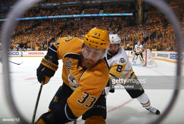 Colin Wilson of the Nashville Predators and Brian Dumoulin of the Pittsburgh Penguins skate in the corner in the first period of Game Six of the 2017...