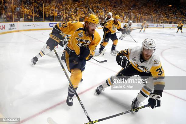 Colin Wilson of the Nashville Predators and Carter Rowney of the Pittsburgh Penguins battle for position during the third period in Game Six of the...