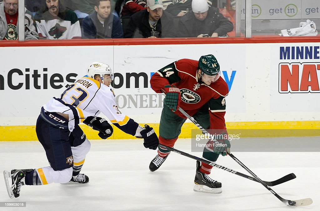 Colin Wilson #33 of the Nashville Predators attempts to get the puck away from <a gi-track='captionPersonalityLinkClicked' href=/galleries/search?phrase=Justin+Falk&family=editorial&specificpeople=4324950 ng-click='$event.stopPropagation()'>Justin Falk</a> #44 of the Minnesota Wild during the second period of the game on January 22, 2013 at Xcel Energy Center in St Paul, Minnesota. The Predators defeated the Wild 3-1.