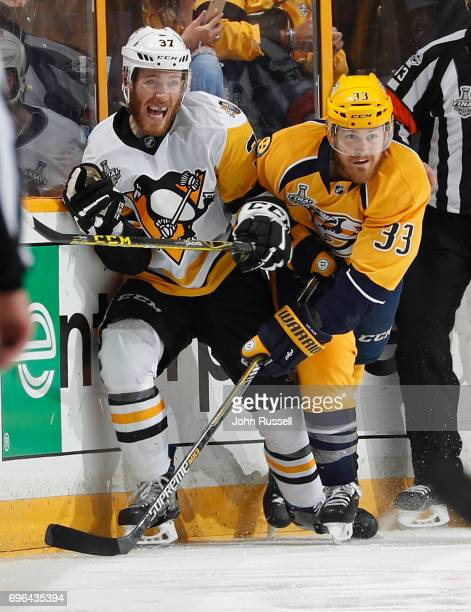 Colin Wilson of the Nashville Predators battles against Carter Rowney of the Pittsburgh Penguins during Game Six of the 2017 NHL Stanley Cup Final at...