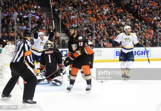 Colin Wilson of the Nashville Predators celebrates after scoring as Ryan Getzlaf of the Anaheim Ducks reacts in the second period of Game Five of the...