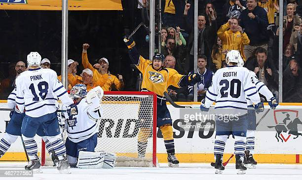 Colin Wilson of the Nashville Predators celebrates his game winning goal against Jonathan Bernier of the Toronto Maple Leafs during an NHL game at...