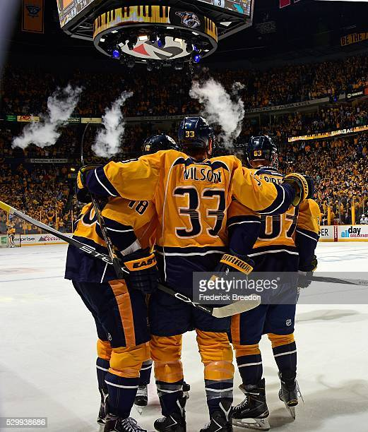 Colin Wilson of the Nashville Predators celebrates with teammates James Neal and Mike Ribiero after scoring the game tying goal during the third...