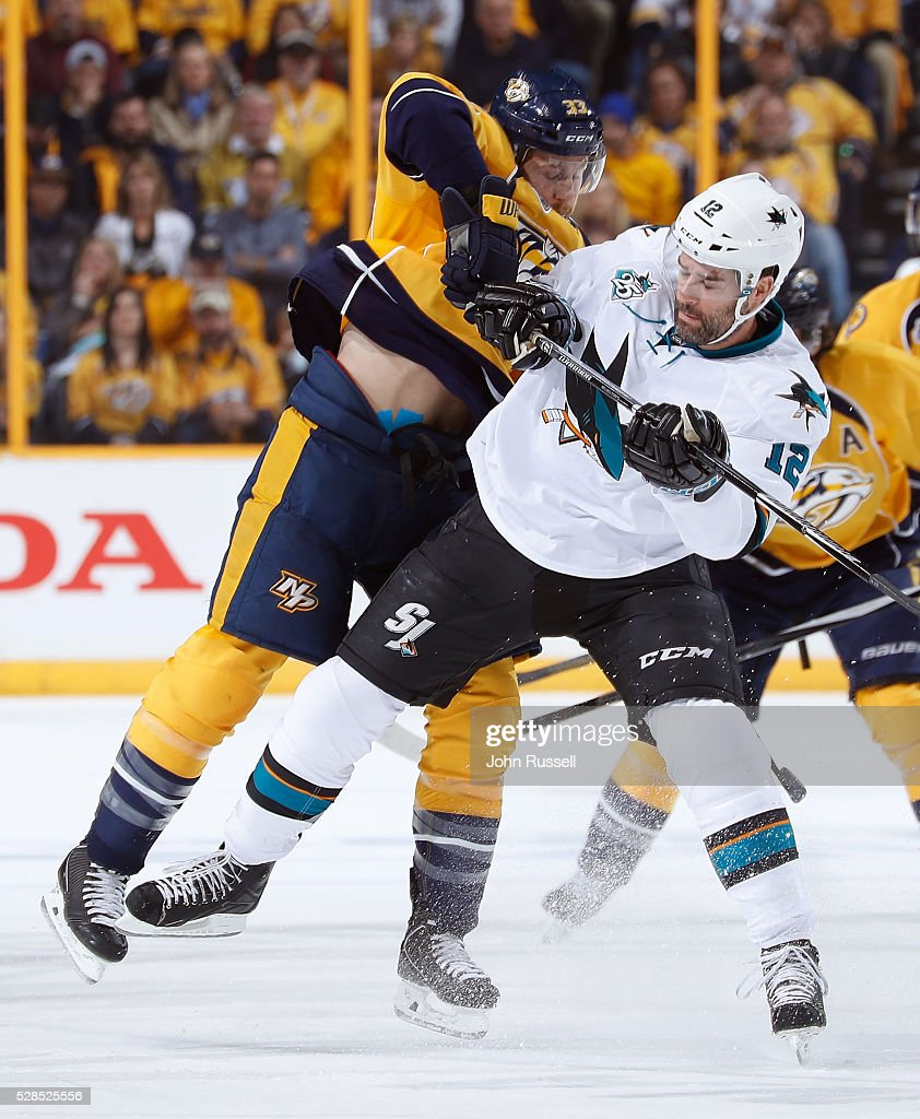 Colin Wilson #33 of the Nashville Predators checks <a gi-track='captionPersonalityLinkClicked' href=/galleries/search?phrase=Patrick+Marleau&family=editorial&specificpeople=203165 ng-click='$event.stopPropagation()'>Patrick Marleau</a> #12 of the San Jose Sharks in Game Four of the Western Conference Second Round during the 2016 NHL Stanley Cup Playoffs at Bridgestone Arena on May 5, 2016 in Nashville, Tennessee.