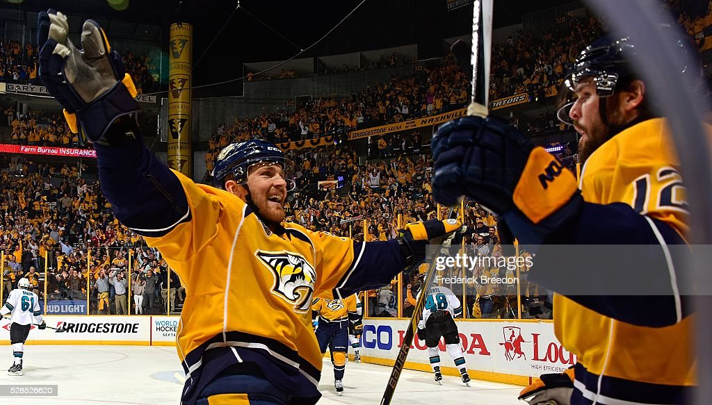 Colin Wilson #33 of the Nashville Predators congratulates teammate <a gi-track='captionPersonalityLinkClicked' href=/galleries/search?phrase=Mike+Fisher+-+Ishockeyspelare&family=editorial&specificpeople=204732 ng-click='$event.stopPropagation()'>Mike Fisher</a> #12 on scoring a goal against of the San Jose Sharks during the first period of Game Four of the Western Conference Second Round during the 2016 NHL Stanley Cup Playoffs at Bridgestone Arena on May 5, 2016 in Nashville, Tennessee.