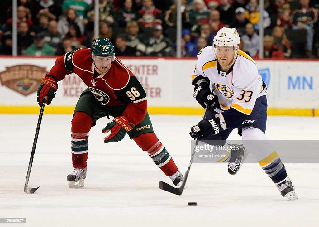 Colin Wilson #33 of the Nashville Predators controls the puck against Pierre-Marc Bouchard #96 of the Minnesota Wild during the first period of the game on January 22, 2013 at Xcel Energy Center in St Paul, Minnesota.