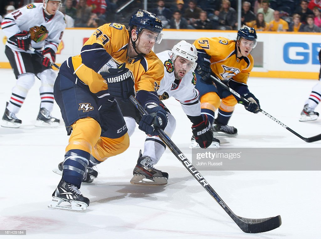 Colin Wilson #33 of the Nashville Predators drives to the net against <a gi-track='captionPersonalityLinkClicked' href=/galleries/search?phrase=Nick+Leddy&family=editorial&specificpeople=5894600 ng-click='$event.stopPropagation()'>Nick Leddy</a> #8 of the Chicago Blackhawks during an NHL game at the Bridgestone Arena on February 10, 2013 in Nashville, Tennessee.