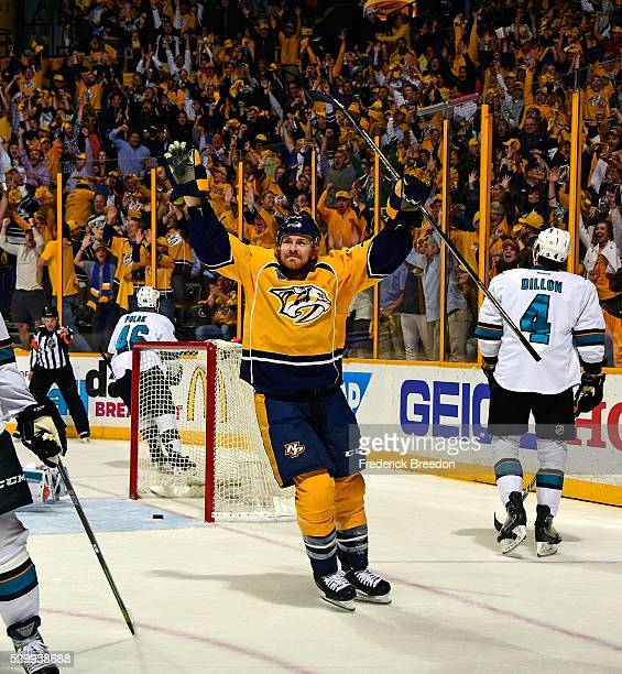 Colin Wilson of the Nashville Predators holds his hands up in celebration after scoring the game tying goal during the third period of Game Six of...