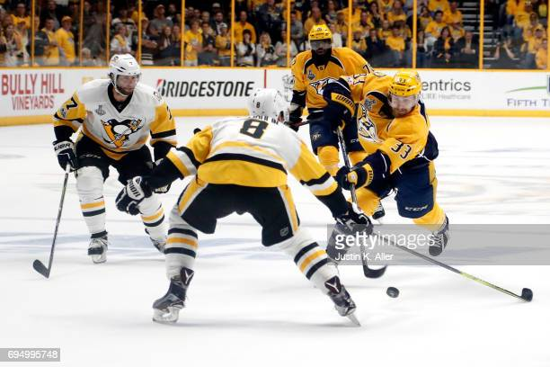 Colin Wilson of the Nashville Predators is defended by Brian Dumoulin of the Pittsburgh Penguins during the first period in Game Six of the 2017 NHL...