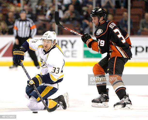 Colin Wilson of the Nashville Predators makes a pass from his knees in front of Matt Beleskey of the Anaheim Ducks during the first period at Honda...