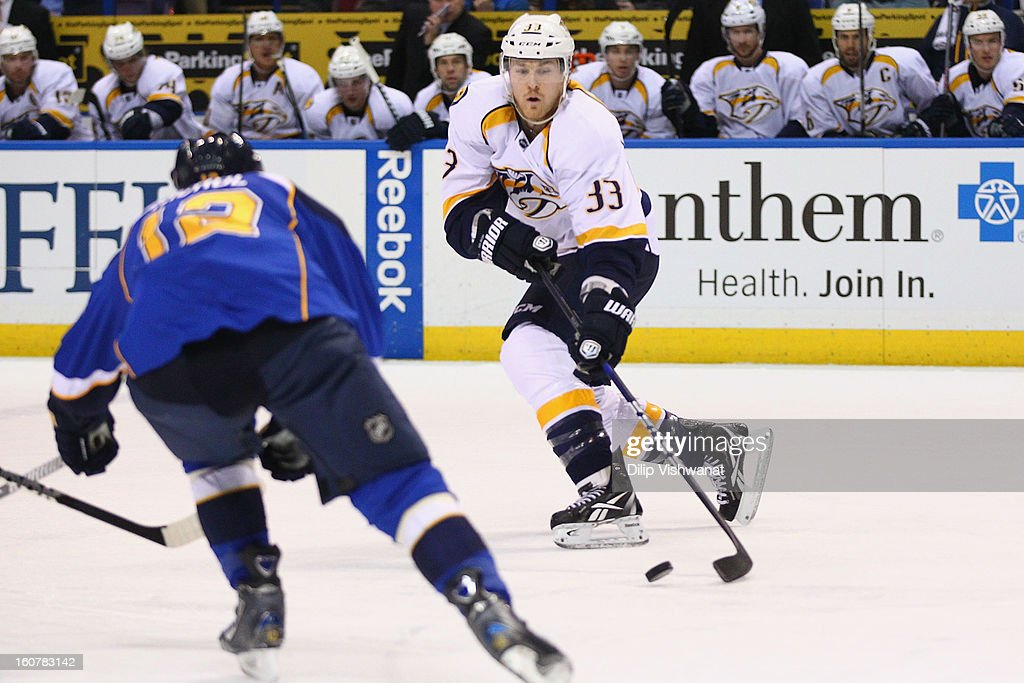 Colin Wilson #33 of the Nashville Predators moves the puck up ice against the St. Louis Blues at the Scottrade Center on February 5, 2013 in St. Louis, Missouri.