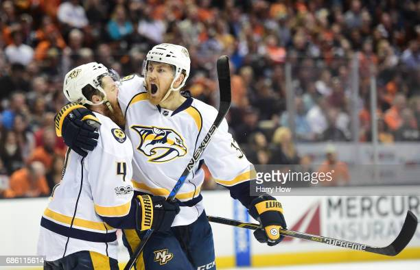 Colin Wilson of the Nashville Predators reacts as he hugs teammate Ryan Ellis after scoring in the second period of Game Five of the Western...