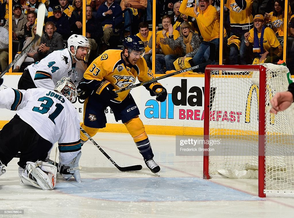 Colin Wilson #33 of the Nashville Predators scores a goal against goalie <a gi-track='captionPersonalityLinkClicked' href=/galleries/search?phrase=Martin+Jones+-+Hockeyspelare&family=editorial&specificpeople=12318960 ng-click='$event.stopPropagation()'>Martin Jones</a> #31 of the San Jose Sharks during the first period of Game Four of the Western Conference Second Round during the 2016 NHL Stanley Cup Playoffs at Bridgestone Arena on May 5, 2016 in Nashville, Tennessee.