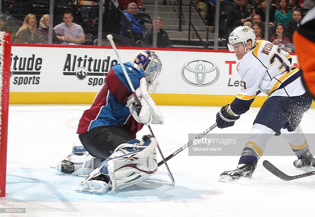 Colin Wilson #33 of the Nashville Predators scores a goal against goaltender <a gi-track='captionPersonalityLinkClicked' href=/galleries/search?phrase=Semyon+Varlamov&family=editorial&specificpeople=6264893 ng-click='$event.stopPropagation()'>Semyon Varlamov</a> #1 of the Colorado Avalanche at the Pepsi Center on February 18, 2013 in Denver, Colorado.
