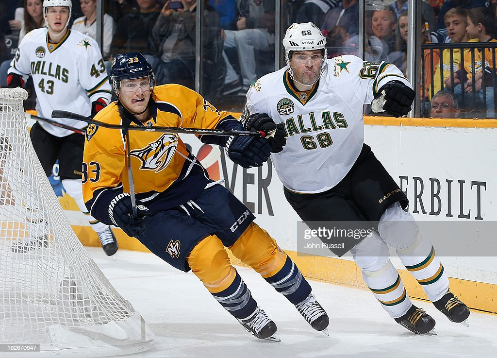Colin Wilson #33 of the Nashville Predators skates against <a gi-track='captionPersonalityLinkClicked' href=/galleries/search?phrase=Jaromir+Jagr&family=editorial&specificpeople=201633 ng-click='$event.stopPropagation()'>Jaromir Jagr</a> #68 of the Dallas Stars during an NHL game at the Bridgestone Arena on February 25, 2013 in Nashville, Tennessee.