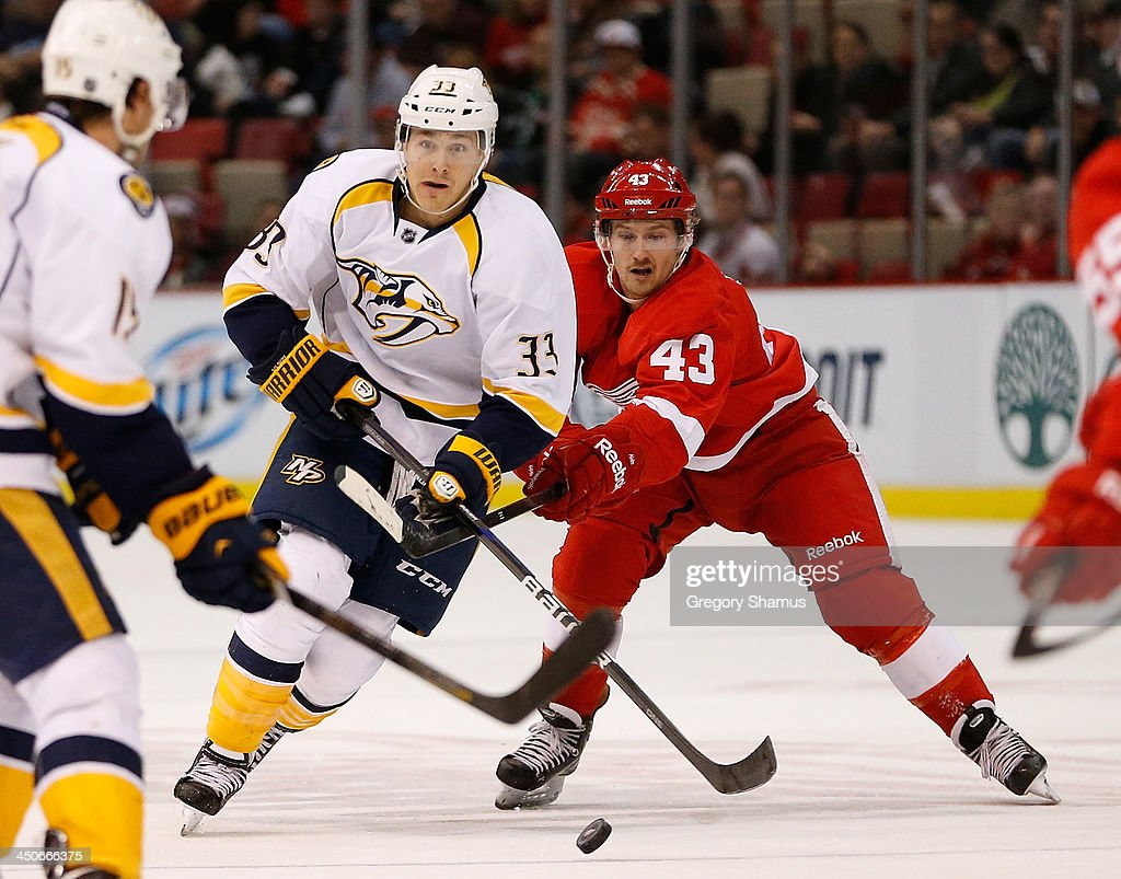 Colin Wilson #33 of the Nashville Predators skates around the stick of <a gi-track='captionPersonalityLinkClicked' href=/galleries/search?phrase=Darren+Helm&family=editorial&specificpeople=3949334 ng-click='$event.stopPropagation()'>Darren Helm</a> #43 of the Detroit Red Wings during the third period at Joe Louis Arena on November 19, 2013 in Detroit, Michigan. Nashville won the game 2-0.