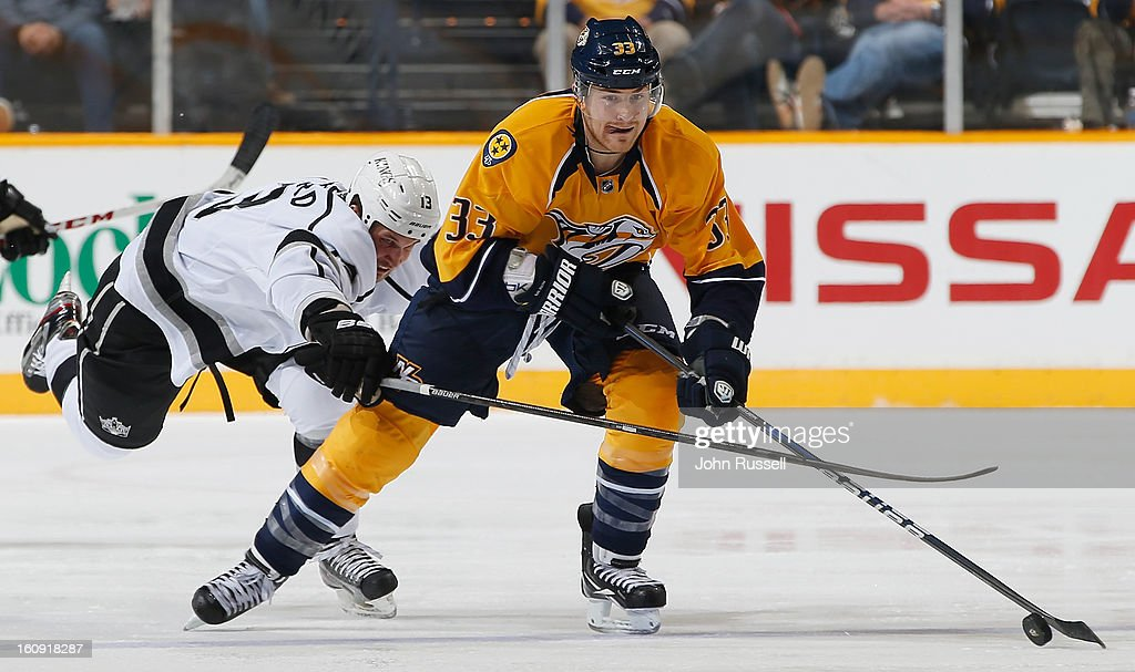 Colin Wilson #33 of the Nashville Predators skates away from <a gi-track='captionPersonalityLinkClicked' href=/galleries/search?phrase=Kyle+Clifford&family=editorial&specificpeople=4640225 ng-click='$event.stopPropagation()'>Kyle Clifford</a> #13 of the Los Angeles Kings during an NHL game at the Bridgestone Arena on February 7, 2013 in Nashville, Tennessee.