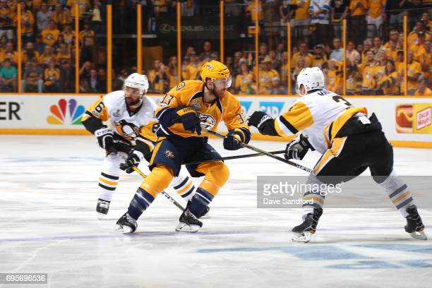 Colin Wilson of the Nashville Predators skates through the neutral zone against Olli Maatta of the Pittsburgh Penguins in the first period of Game...