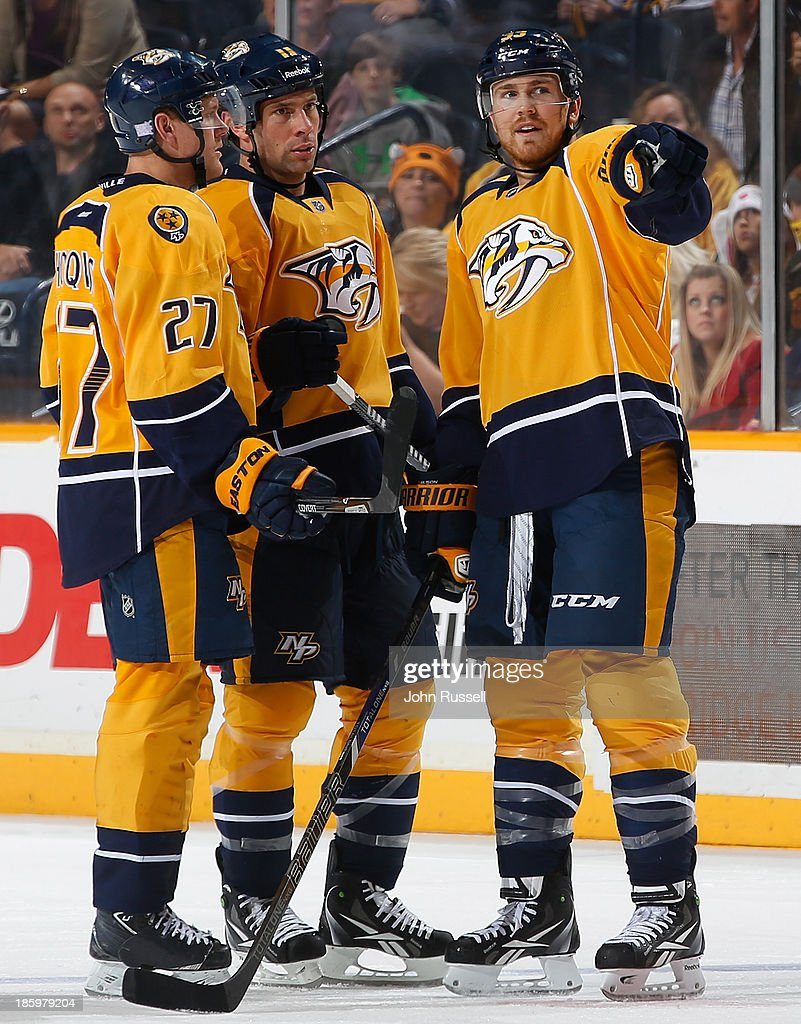 Colin Wilson #33 of the Nashville Predators talks with Predators <a gi-track='captionPersonalityLinkClicked' href=/galleries/search?phrase=David+Legwand&family=editorial&specificpeople=202553 ng-click='$event.stopPropagation()'>David Legwand</a> #11 and <a gi-track='captionPersonalityLinkClicked' href=/galleries/search?phrase=Patric+Hornqvist&family=editorial&specificpeople=1966879 ng-click='$event.stopPropagation()'>Patric Hornqvist</a> #27 during a pause in play against the St. Louis Blues at Bridgestone Arena on October 26, 2013 in Nashville, Tennessee.
