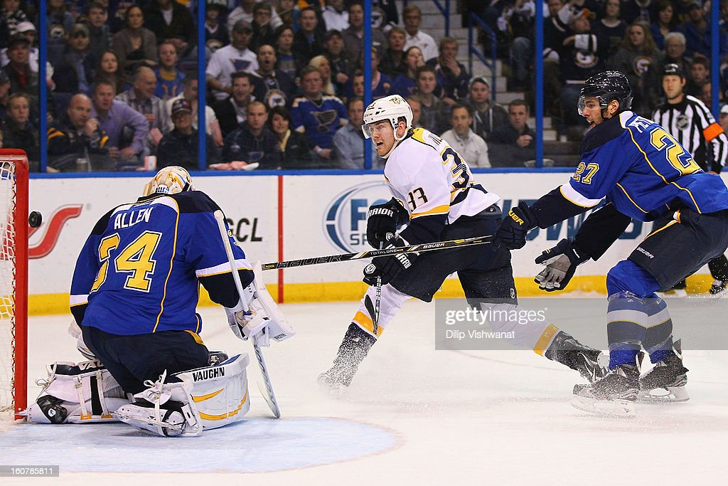 Colin Wilson #33 on\ scores a goal against Jake Allen #34 and <a gi-track='captionPersonalityLinkClicked' href=/galleries/search?phrase=Alex+Pietrangelo&family=editorial&specificpeople=4072229 ng-click='$event.stopPropagation()'>Alex Pietrangelo</a> #27 both of the St. Louis Blues at the Scottrade Center on February 5, 2013 in St. Louis, Missouri.
