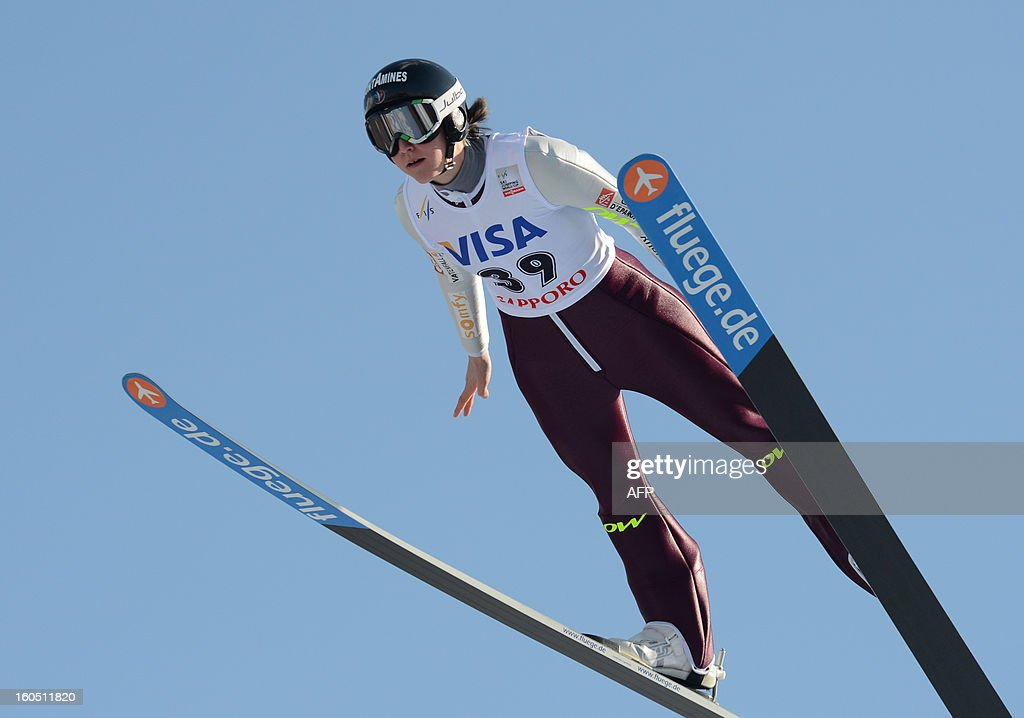 Coline Mattel of France soars in the air during the World Cup women's ski jumping in Sapporo in Japan's northern island of Hokkaido on February 2, 2013. Mattel scored 120.02 points and captured her second win of the season to move up to second in the overall standings. AFP PHOTO / Takashi NOGUCHI
