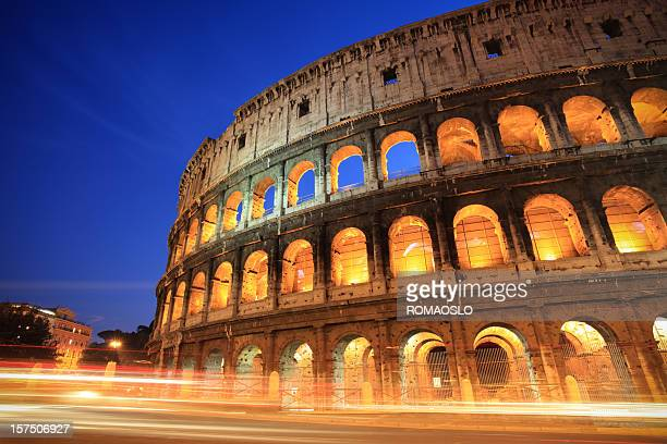 Coliseum by night with traffic,Rome Italy