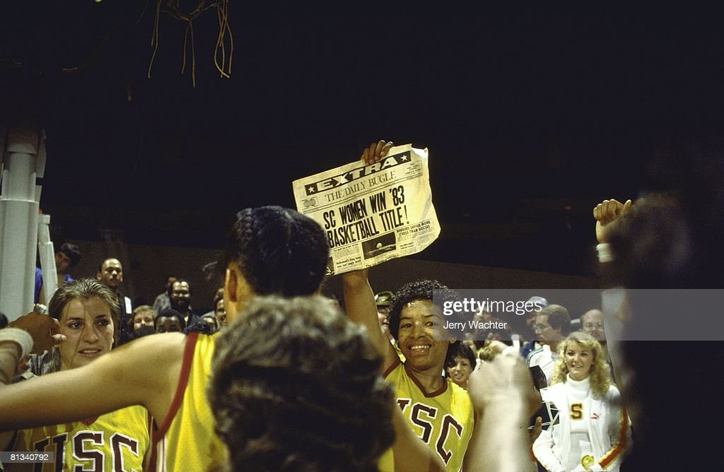 NCAA final, USC's Cynthia Cooper (44) victorious with SC WOMEN WIN '83 BASKETBALL TITLE newspaper after winning game vs Lousiana Tech, Norfolk, VA 4/2/1983