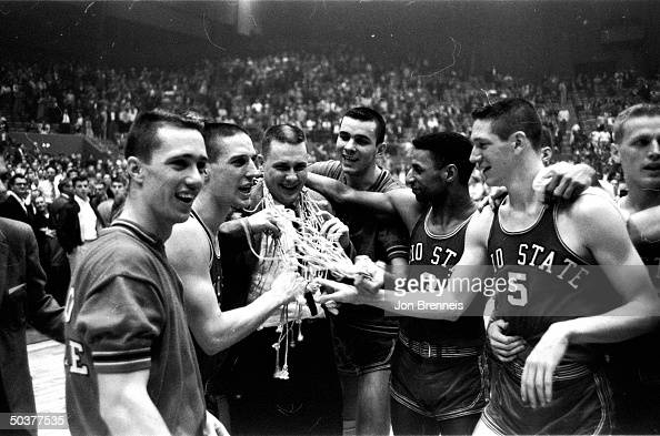 NCAA Finals Portrait of Ohio St players Larry Siegfried Jerry Lucas Mel Nowell John Havlicek victorious w coach Fred Taylor after game vs NYU