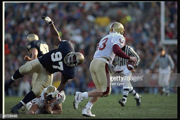 BC's QB Glenn Foley in action vs Notre Dame's Bryant Young