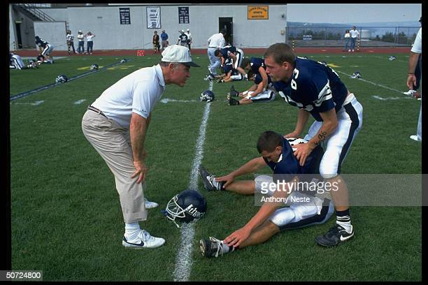 Ithaca Coll Coach Jim Butterfield w players during practice